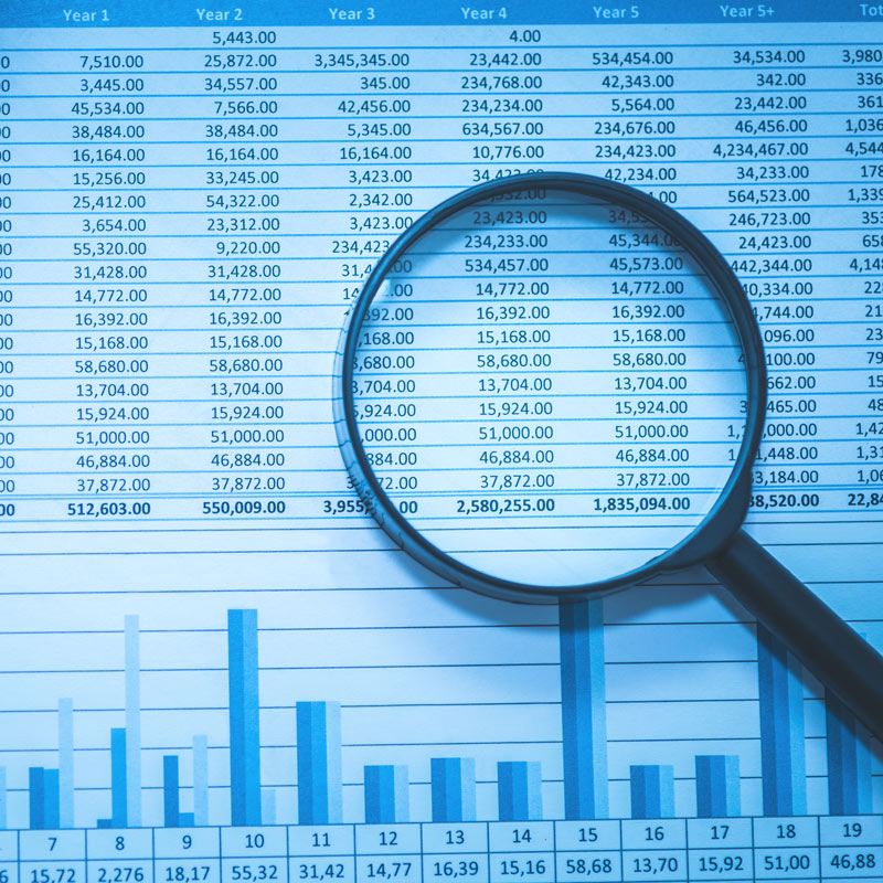 Magnifying glass sitting on top of a page of account numbers