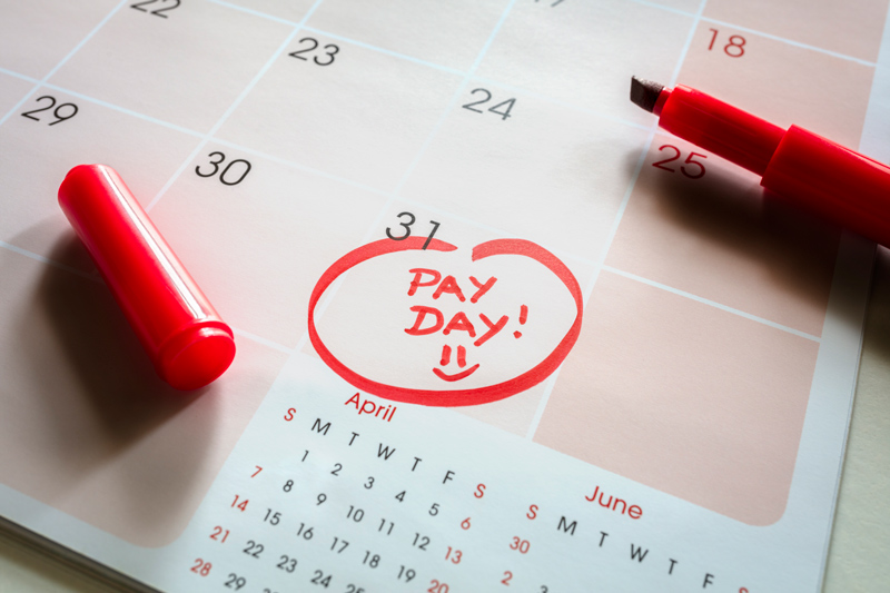 Pay day circled in red on calendar