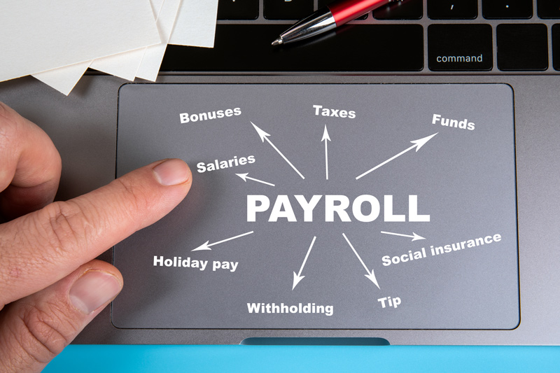 Tracking pad mouse with payroll list laid out on it