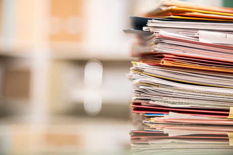 Pile of folders and files with unfocused background
